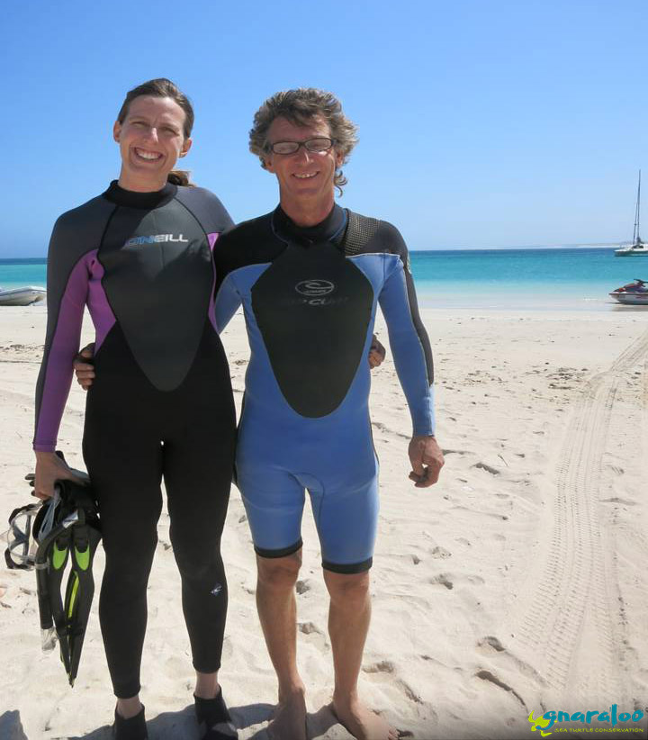 Karen and Paul with their wetsuits